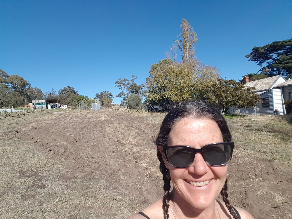 Katie in front of the new block that will be used for growing fruit trees