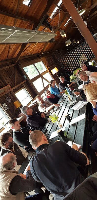 Organic orchardists having a round table discussion at Willie Smith's Apple Shed, in the Huon valley
