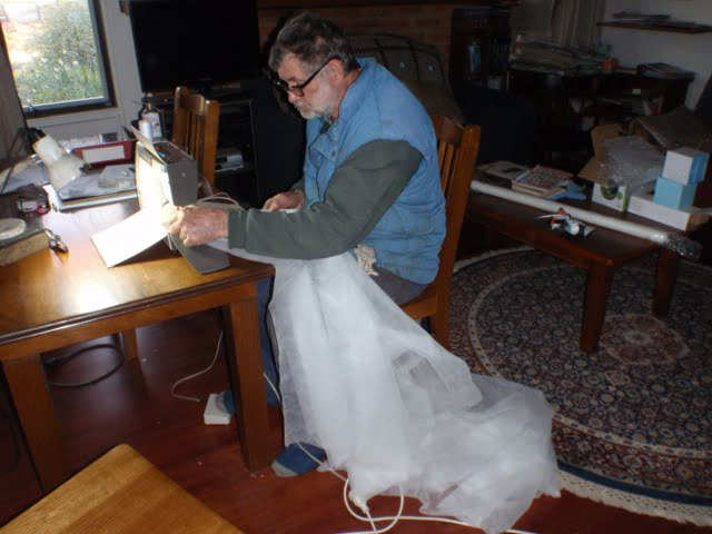 Win hard at work at the sewing machine