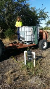 Putting compost tea into the irrigation system