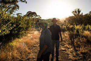 Katie and Hugh in a hot orchard (photo credit: Biomi Photo)