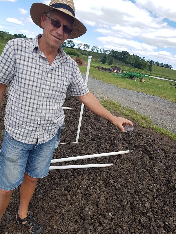 Hugh checking the temperature of the compost pile at Rodale Institute of organic research
