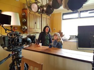 Katie and Miley in the kitchen being filmed for ABC ME series If you see it you can be it