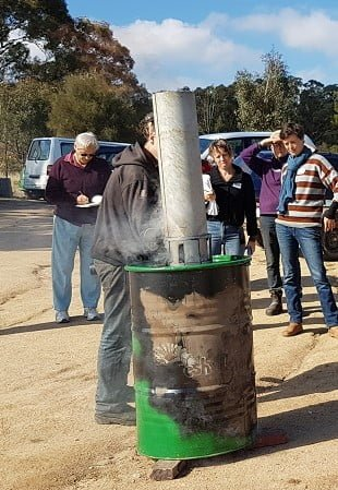 Learning how to make biochar at a workshop at the farm